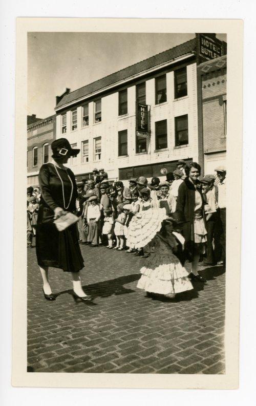 Little girl with parasol, Kaffir Corn Carnival parade, El Dorado, Butler County, Kansas - Page