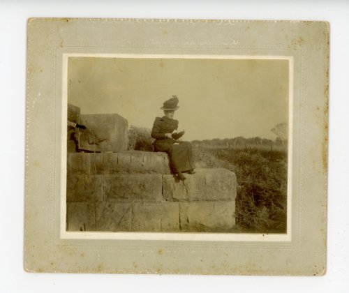 Woman sitting on stone blocks, Butler County, Kansas - Page
