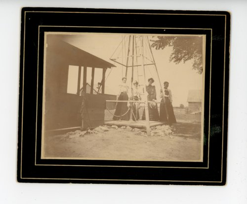 Four farm women beneath a windmill, Butler County, Kansas - Page
