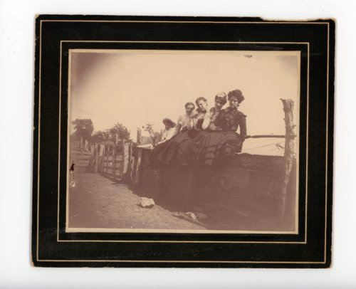 Farm family seated on an outbuilding, Butler County, Kansas - Page