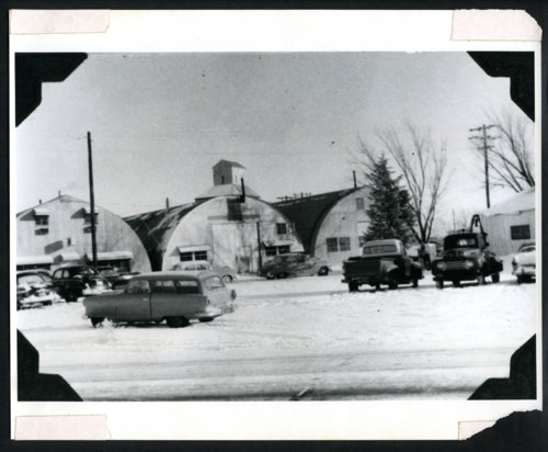 Quonset huts and vehicles at the Hesston Manufacturing Company, Hesston, Kansas - Page
