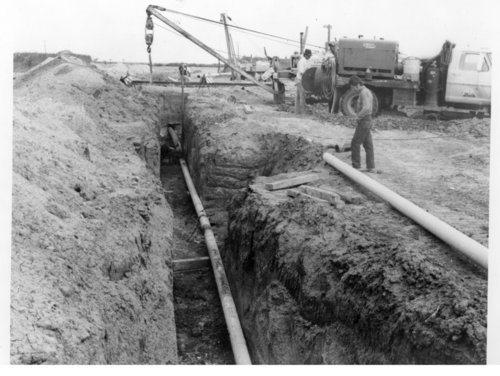 Laying a pipeline across Logan County, Kansas - Page
