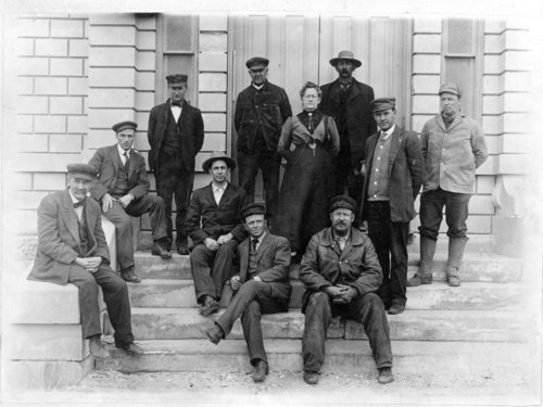 Officers on the steps of the county courthouse, Logan County, Kansas - Page