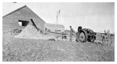 Shelling corn at the Roberts farm, Logan County, Kansas - Page
