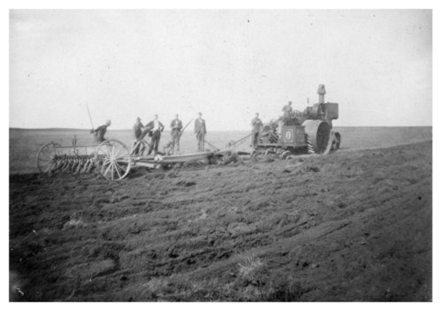 Breaking sod and seeding wheat in a field, Logan County, Kansas - Page
