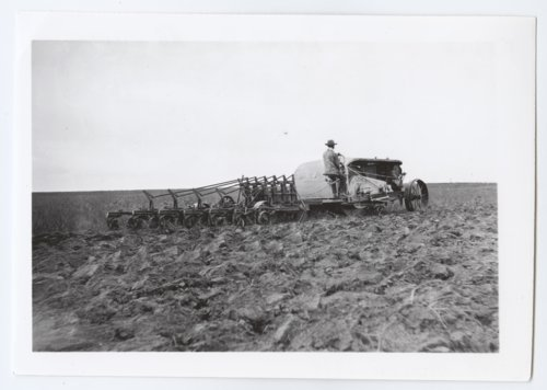 Gray tractor plowing a field, Logan County, Kansas - Page