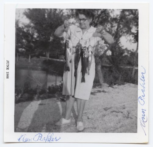 Ann Pichler holding a line of fish, Crawford County, Kansas - Page