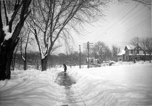 Cleaning a sidewalk after a snow, Valley Falls, Kansas - Page