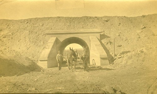 Workmen with a wagon at tunnel, Abo Canyon, New Mexico - Page