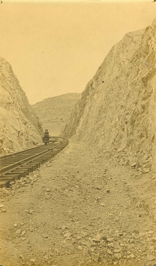 Railroad worker using a hand car, Abo Canyon, New Mexico - Page
