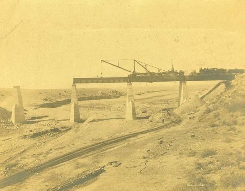 Placing a girder on a railroad bridge, Abo Canyon, New Mexico - Page