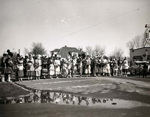 Photograph of women waiting at the starting line for the Shrove Tuesday Pancake Race, Liberal, 1960s.