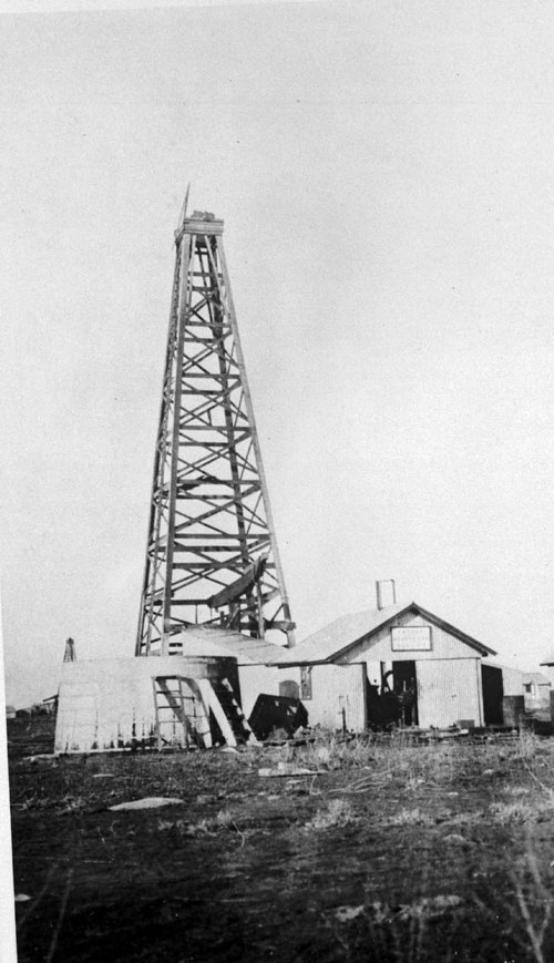 Oil well pump and derrick - Page
