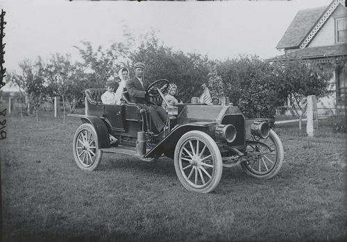 Joseph Brown family in an automobile, Dorrance, Kansas - Page
