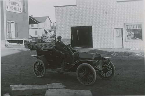 R. E. Brown in Moline automobile, Dorrance, Kansas - Page