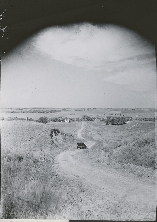 Automobile on country road, Russell County, Kansas - Page