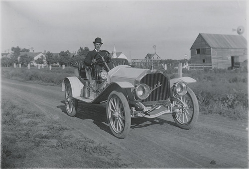 Weber in automobile, Dorrance, Kansas - Page