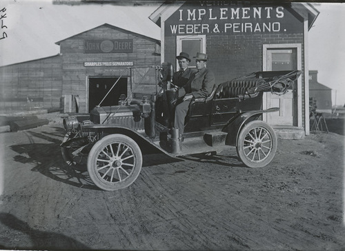 F. W. Jordan and Leo Sterns in an automobile, Dorrance, Kansas - Page