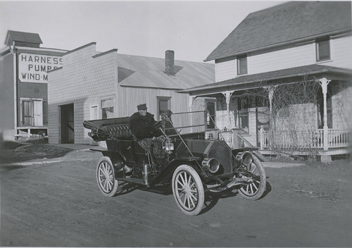 Perry E. Brown and his Moline automobile, Dorrance, Kansas - Page
