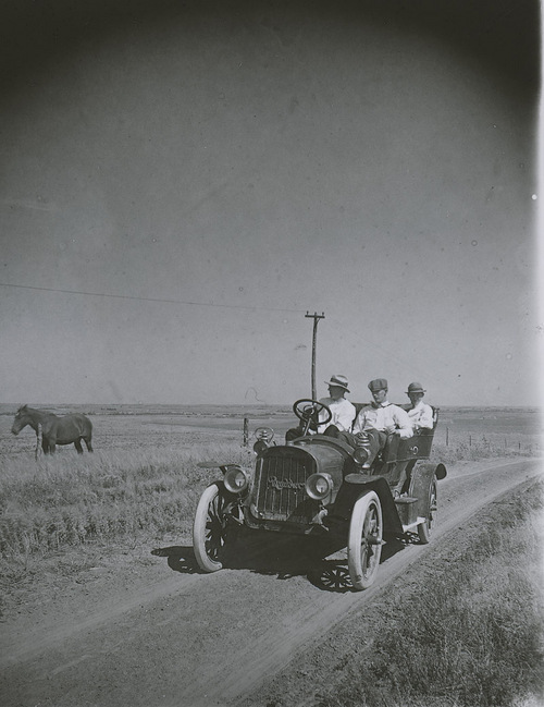 Three men in a Rambler automobile, Russell County, Kansas - Page