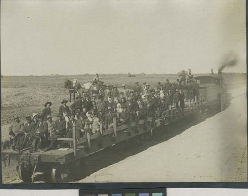 People on a flatbed railroad car - Page