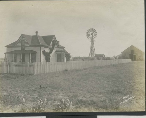 Farmhouse, windmill, shed, and barn in Haskell County, Kansas - Page