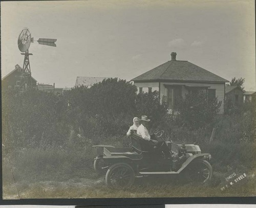 Woman and man in an automobile in Haskell County, Kansas - Page