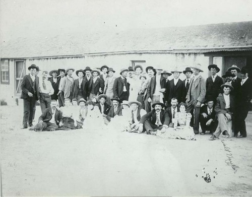 A crowd of people at a house, Seward County, Kansas - Page