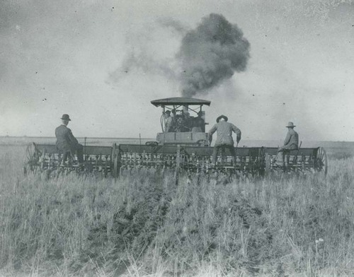 Men working with drills and a steam tractor - Page