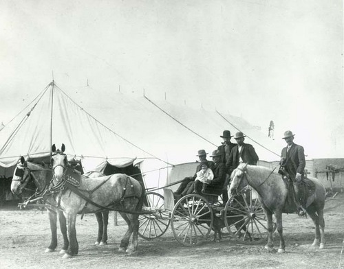 People in carriage in front of a large tent, Seward County, Kansas - Page