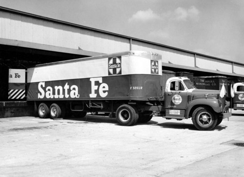 Atchison, Topeka, & Santa Fe truck trailer F3201R backed up to a dock door - Page