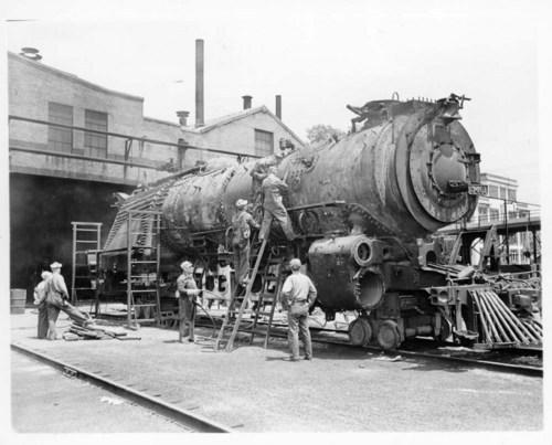 Workers rebuilding engine, Topeka, Kansas - Page