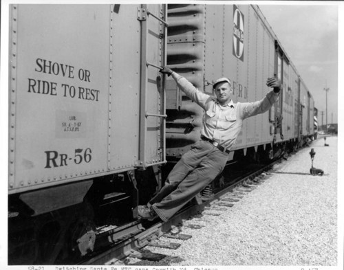 Atchison, Topeka, and Santa Fe employee assisting in switching refrigerator cars in the Corwith yards, Chicago, Illinois - Page