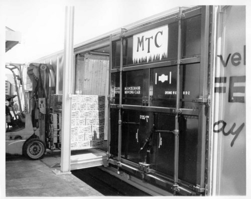 MTC refrigerator car being loaded with canned goods - Page