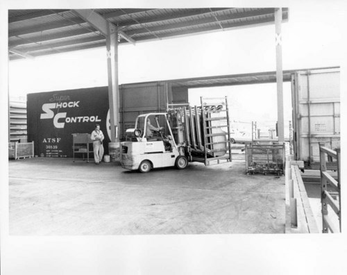Loading automobile fenders, Los Angeles, California - Page