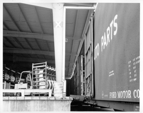 Loading a high cube auto parts boxcar - Page