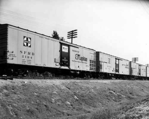 Engine #1355 hauling freight in Apache Canyon, New Mexico - Page